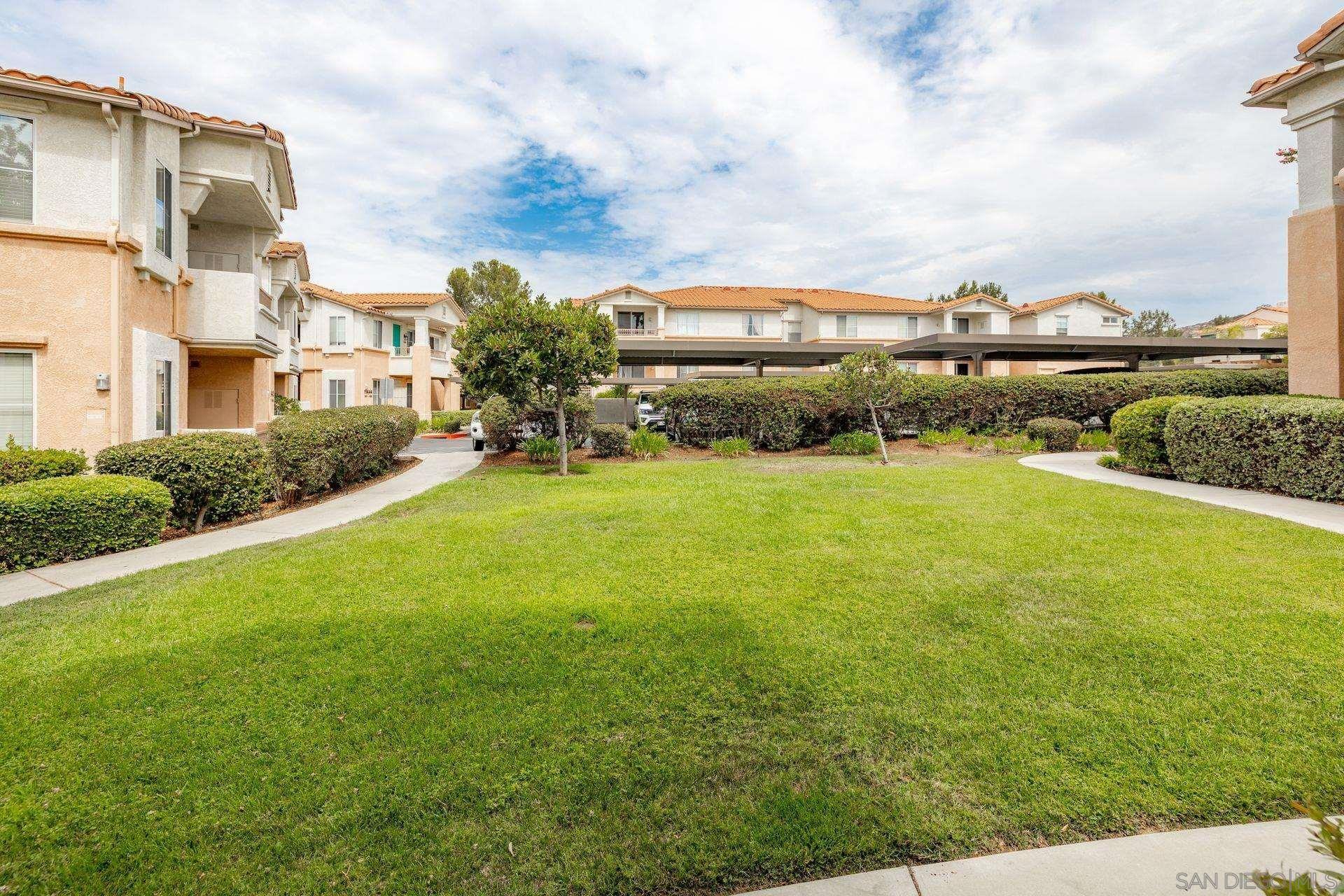 Photo of 11448 Via Rancho San Diego #180, El Cajon, CA 92019 (MLS # 210021143)