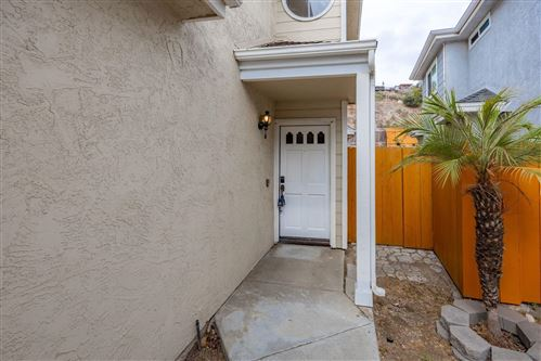 Photo of 3384 Aveley Pl, San Diego, CA 92111 (MLS # 210021154)