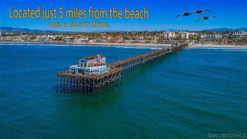 Photo of 230 Venetia Way, Oceanside, CA 92057 (MLS # 210024173)