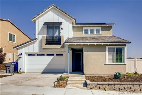 Photo of 8867 Hightail Dr, Santee, CA 92071 (MLS # 210005210)