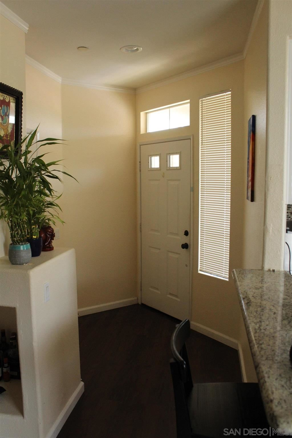 Photo of 10766 Sabre Hill Dr #253, San Diego, CA 92128 (MLS # 210021292)