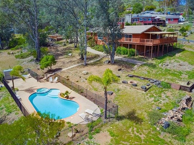 Photo of 11435 Crazy Horse Dr, Lakeside, CA 92040 (MLS # PTP2102293)