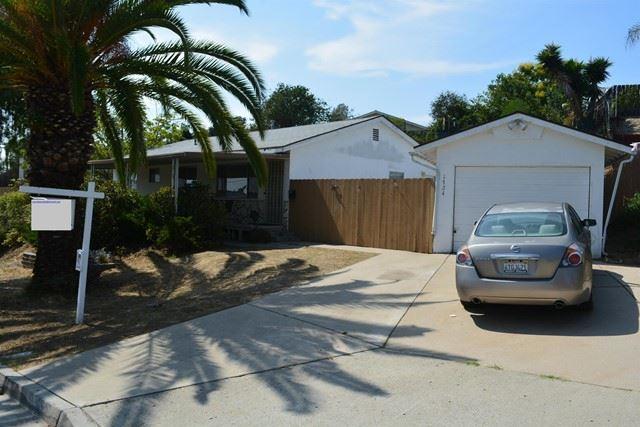 Photo of 1724 Dartmoor Drive, Lemon Grove, CA 91945 (MLS # PTP2106326)