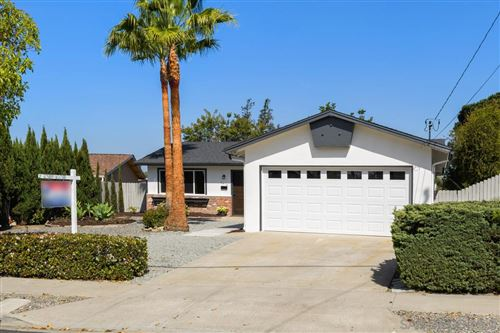 Photo of 5618 Camber Drive, San Diego, CA 92117 (MLS # 210009329)