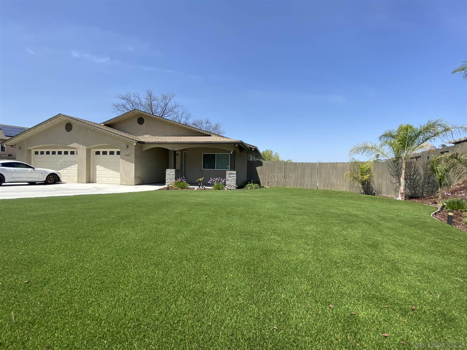 Photo of 9668 Cypress Vale Dr, Lakeside, CA 92040 (MLS # 210009342)