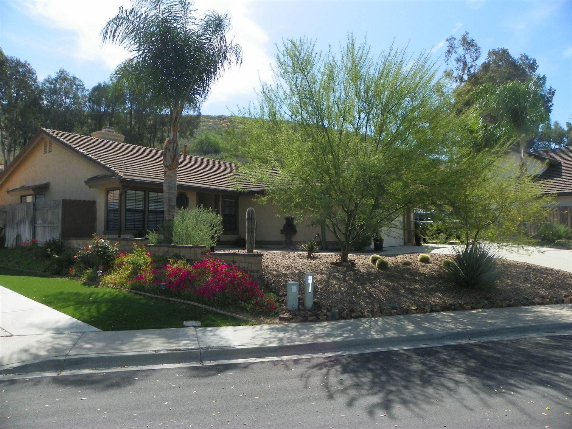 Photo of 9203 SINSONTE LN, LAKESIDE, CA 92040 (MLS # 210009348)
