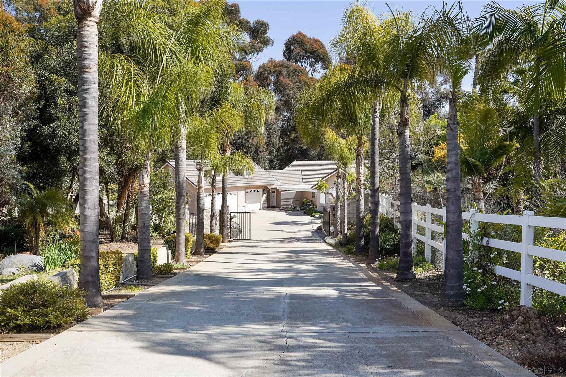 Photo of 656 Altamira Ct, Vista, CA 92081 (MLS # 210008353)