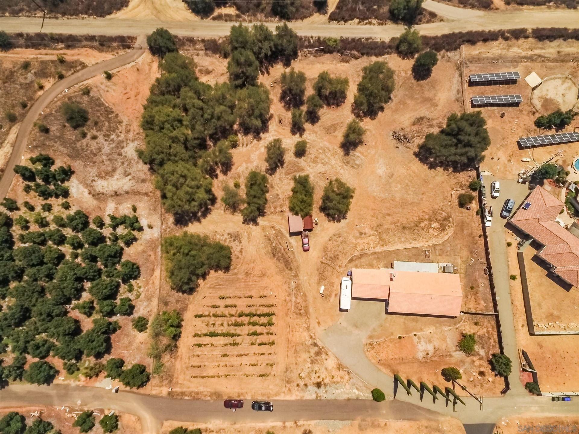 Photo of 10257 Bakton Way, Valley Center, CA 92082 (MLS # 210025356)