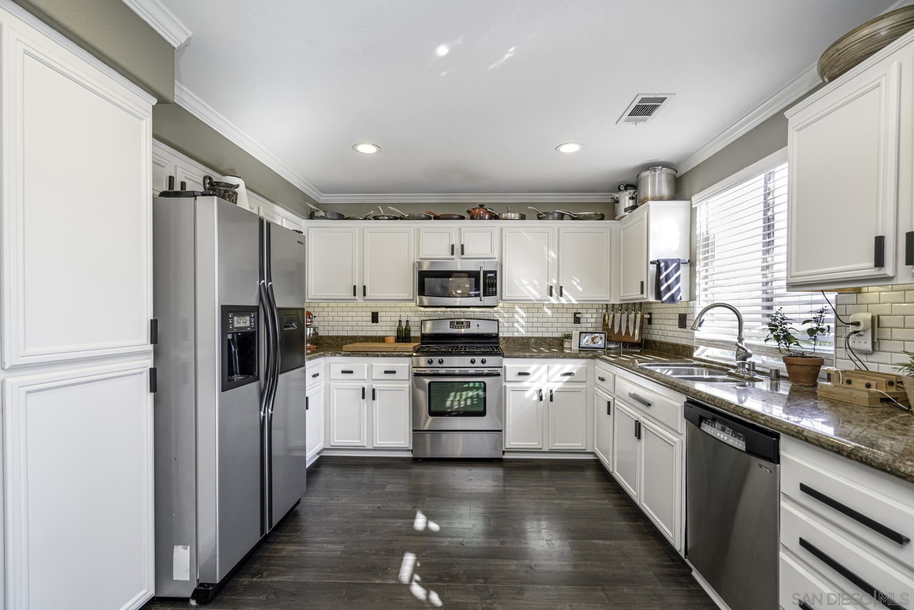 Photo of 13383 Goldentop Dr, Lakeside, CA 92040 (MLS # 210026391)