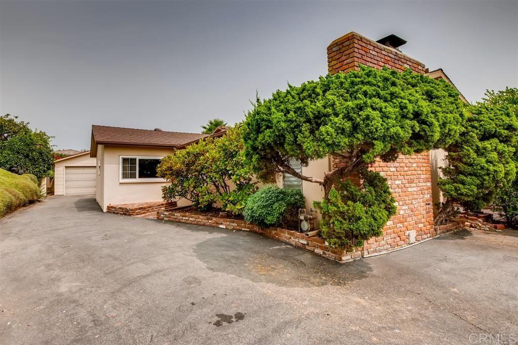 Photo of 1410 Alta Vista Drive, Vista, CA 92084 (MLS # 200044400)