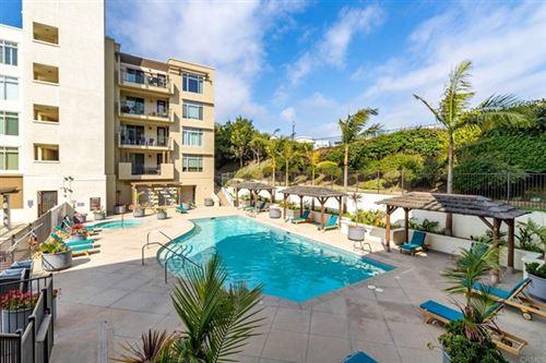 Photo of 1019 Costa Pacifica Way #1107, Oceanside, CA 92054 (MLS # NDP2105412)