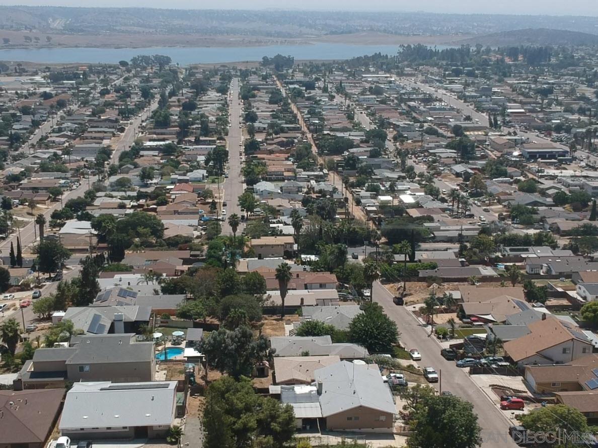 Photo of 1205 RAMONA AVE, Spring Valley, CA 91977 (MLS # 210024412)