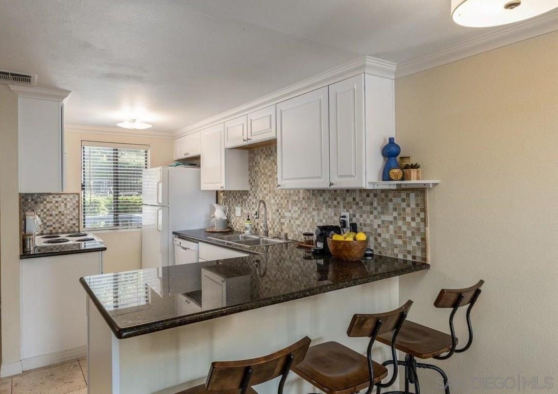 Photo of 2340 Caringa Way #D, Carlsbad, CA 92009 (MLS # 210021419)