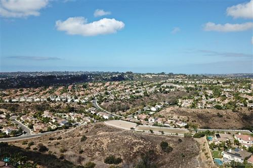 Photo of 12910 Seabreeze Farms Dr, San Diego, CA 92130 (MLS # 210007435)