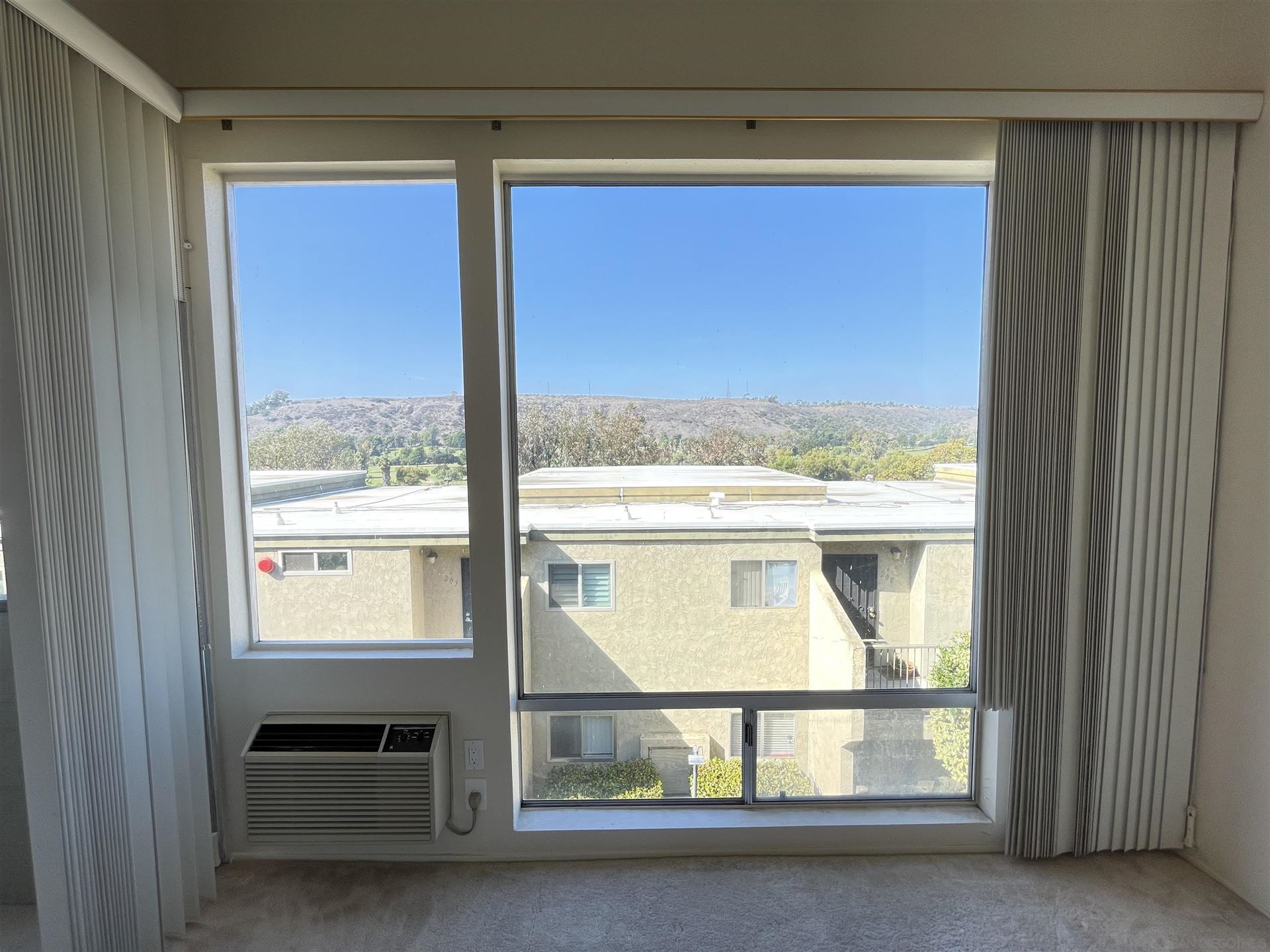 Photo of 6675 Mission Gorge Rd #A307, San Diego, CA 92120 (MLS # 210025445)