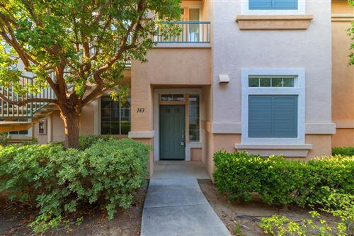 Photo of 10750 Sabre Hill Dr #143, San Diego, CA 92128 (MLS # 210017455)