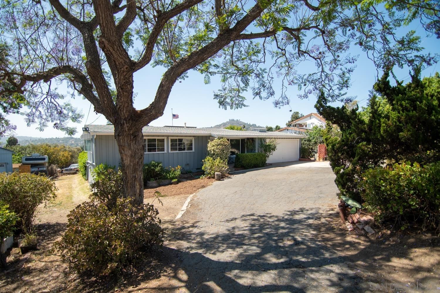 Photo of 10328 Ramona Dr, Spring Valley, CA 91977 (MLS # 210014483)