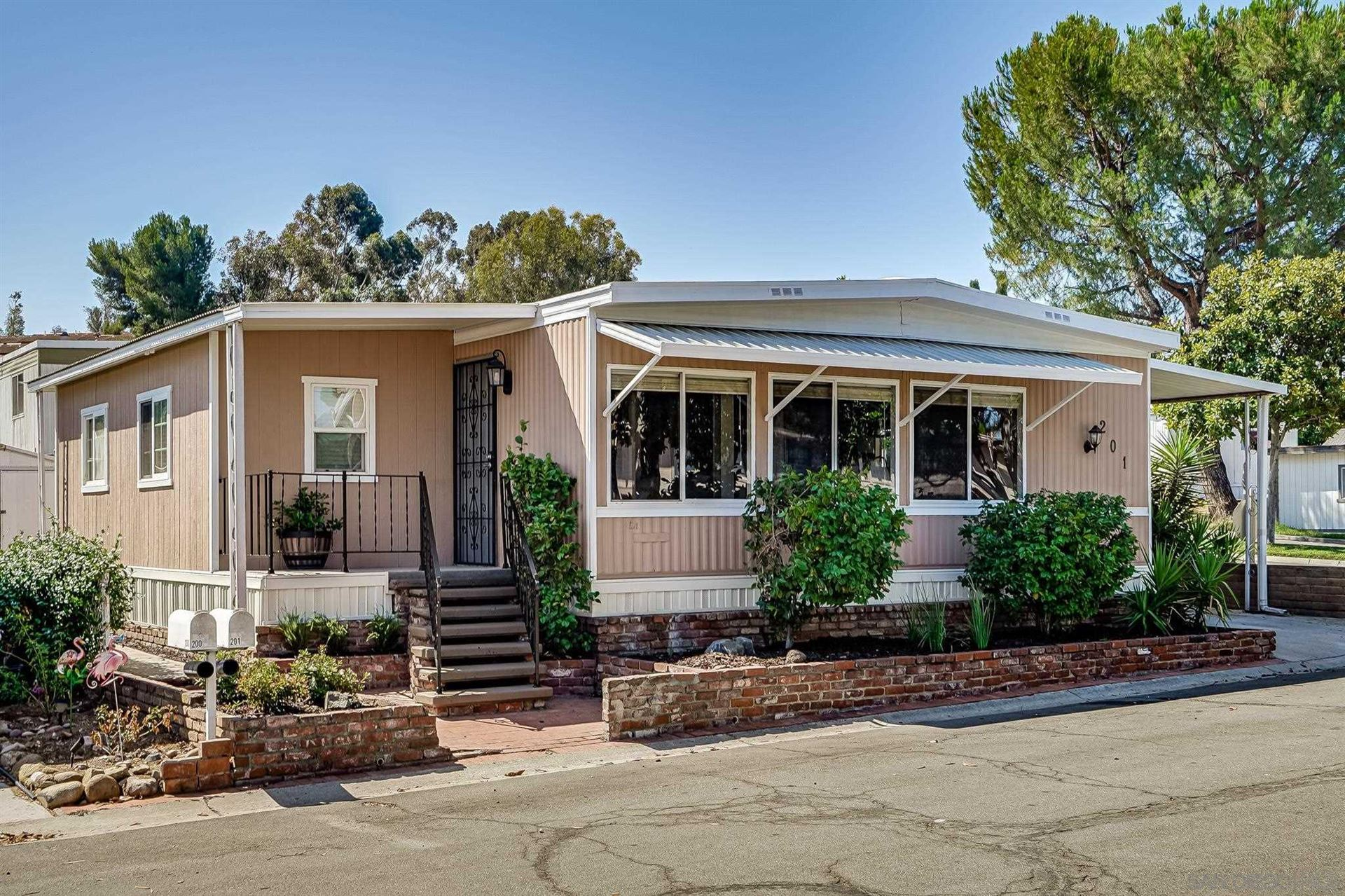 Photo of 10800 Woodside Ave SPC 201, Santee, CA 92071 (MLS # 210021521)