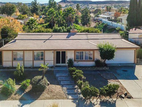 Photo of 8647 Carlton Oaks Dr, Santee, CA 92071 (MLS # 200054530)