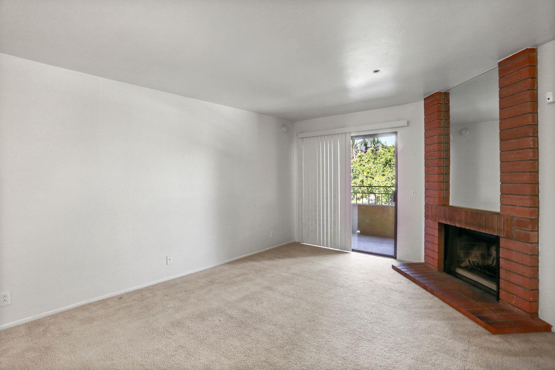 Photo of 5649 Lake Park Way #106, La Mesa, CA 91942 (MLS # 210011535)