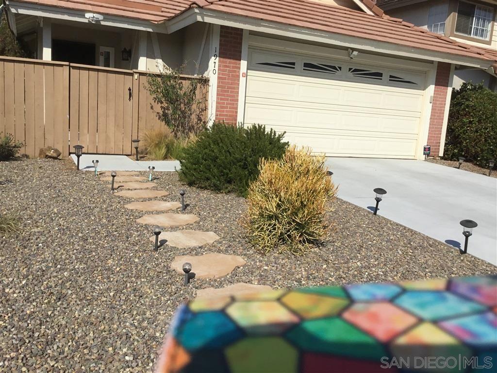 Photo of 1970 Elm Ridge Dr, Vista, CA 92081 (MLS # 200040609)