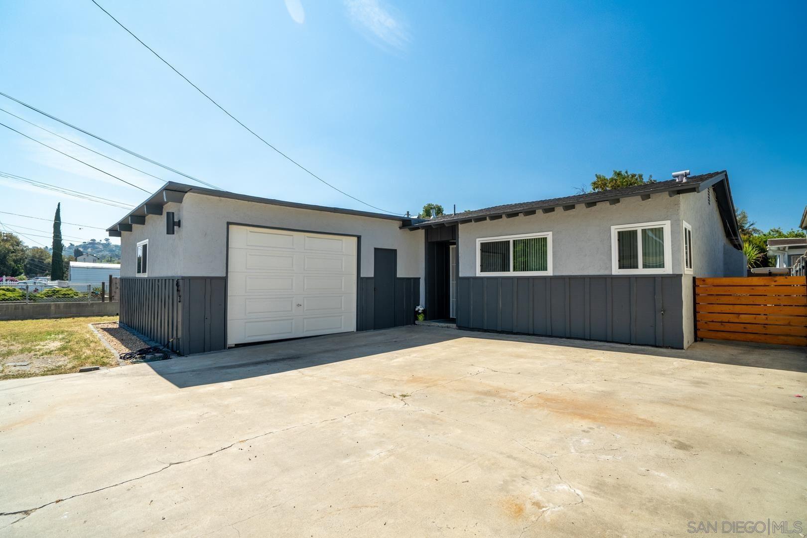 Photo of 8813 Lamar Street, Spring Valley, CA 91977 (MLS # 210015611)