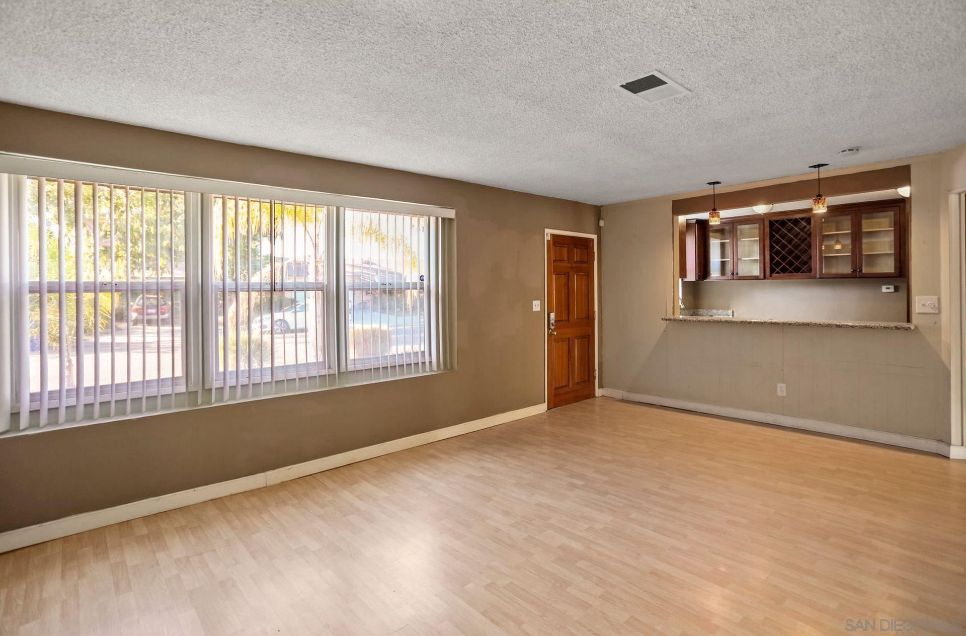 Photo of 9028 Davenrich St, Spring Valley, CA 91977 (MLS # 210029620)