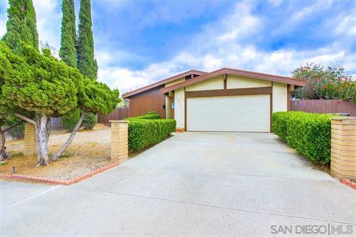 Photo of 8621 Carlton Oaks Dr, Santee, CA 92071 (MLS # 210011623)