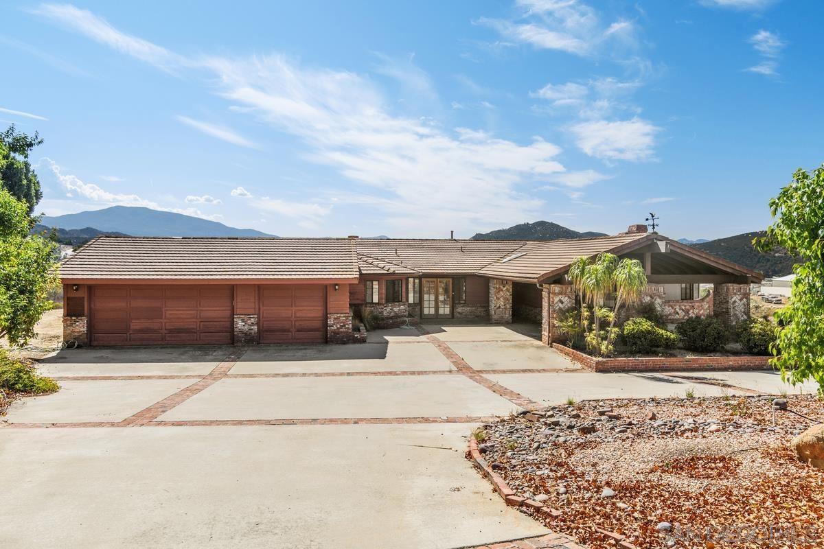 Photo of 10099 El Capitan Real Rd, El Cajon, CA 92021 (MLS # 210021638)