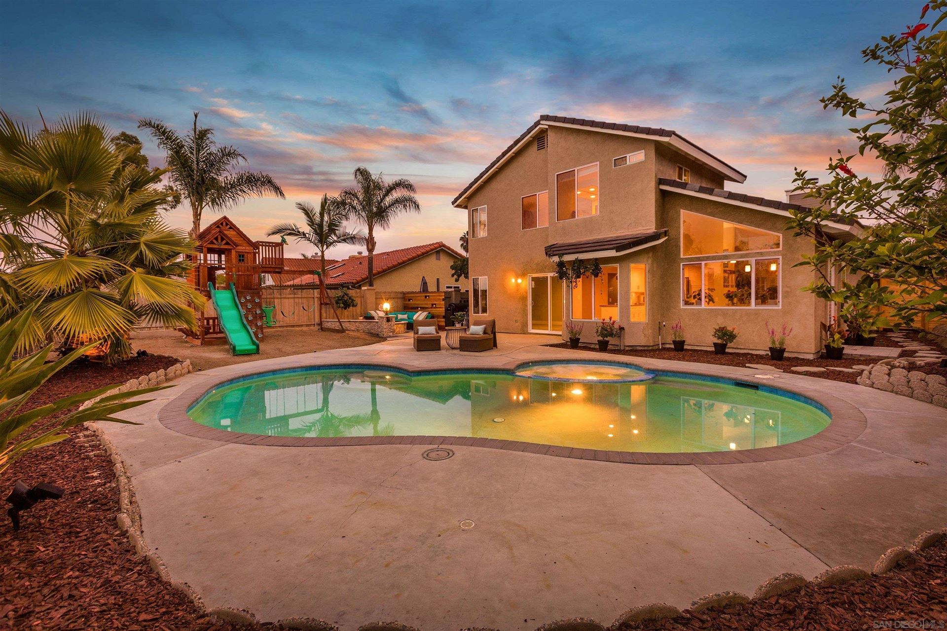 Photo of 5240 Sandalwood Pl, Oceanside, CA 92056 (MLS # 210029674)