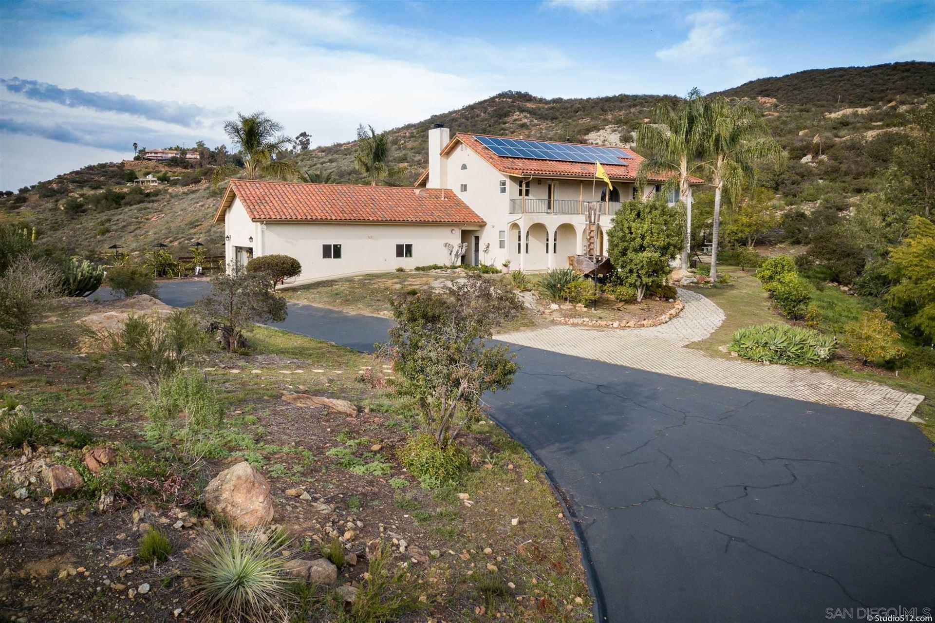 Photo of 13190 Dermid Rd, Valley Center, CA 92082 (MLS # 210006762)
