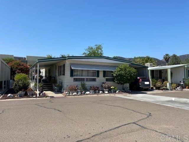 Photo of 8301 Mission Gorge Rd #204, Santee, CA 92071 (MLS # PTP2103886)