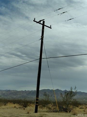 Photo of Corner of Two Mile Rd and Hollinger Rd, Joshua Tree, CA 92252 (MLS # PTP2106969)