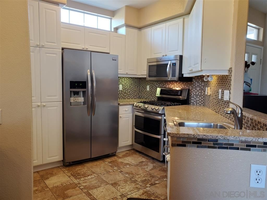 Photo of 10776 Sabre Hill Dr #251, San Diego, CA 92128 (MLS # 200030997)