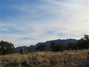 Photo of 100 Acre Tract Madrid Heights, NM Highway 14, Madrid, NM 87010 (MLS # 201704521)
