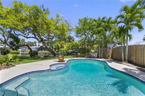 Photo of 52 Riverview Lane, Cocoa Beach, FL 32931 (MLS # 878082)