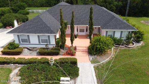 Photo of 1805 Plantation Circle, Palm Bay, FL 32909 (MLS # 911182)