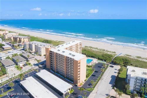 Photo of 7520 Ridgewood Avenue #104, Cocoa Beach, FL 32931 (MLS # 894404)