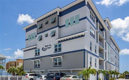 Photo of 6015 Turtle Beach Lane #204, Cocoa Beach, FL 32931 (MLS # 891668)