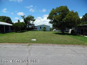 Photo of 934 Hyacinth Circle, Barefoot Bay, FL 32976 (MLS # 863774)