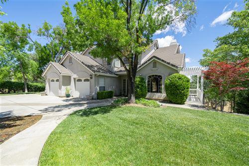 Photo of 8725 Landmark Cir, Redding, CA 96001 (MLS # 21-2691)