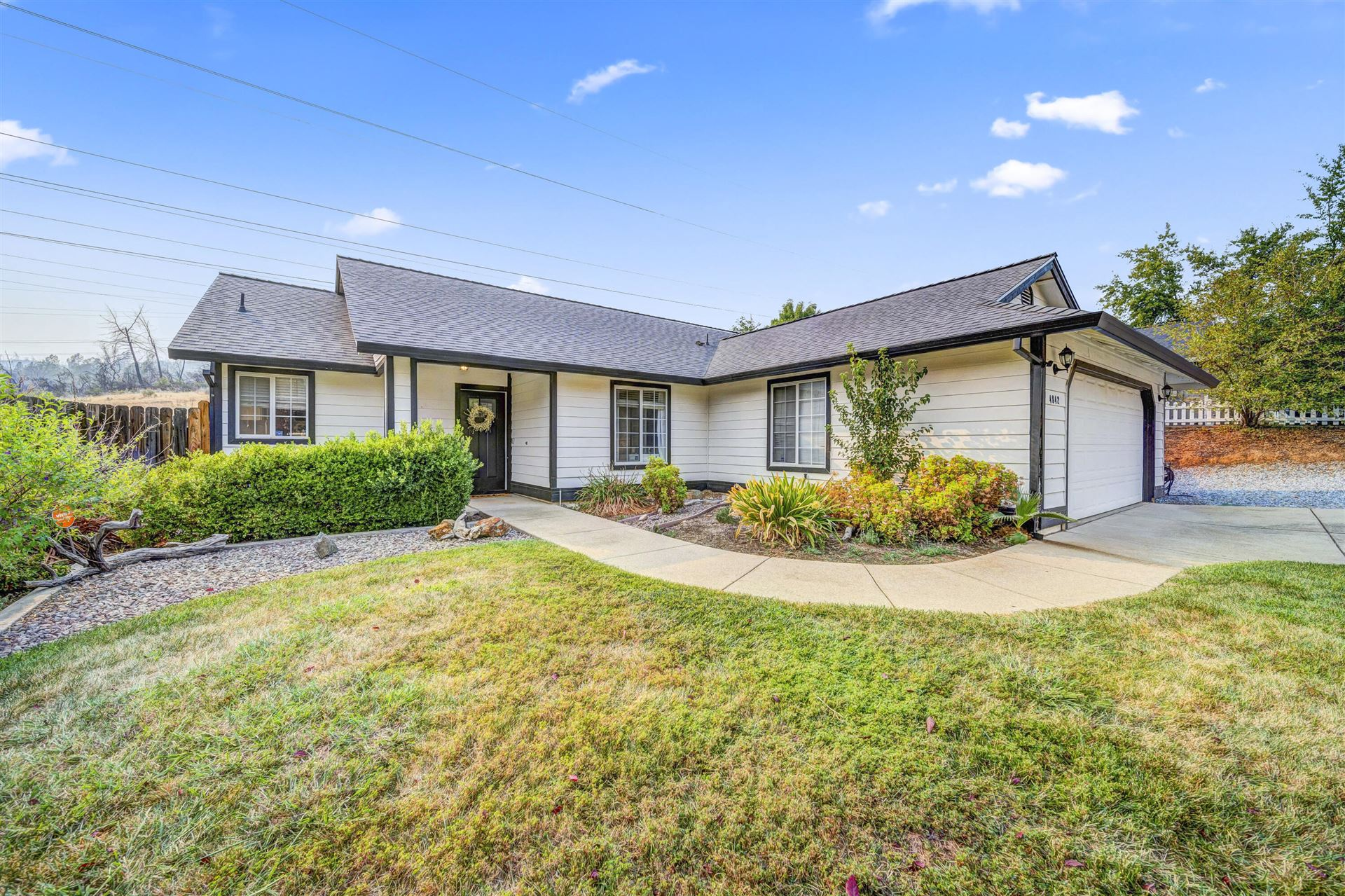 Photo of 4842 Tralee Ln, Redding, CA 96001 (MLS # 21-4766)