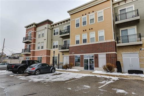 Photo of 111 W Fulton St #213, Edgerton, WI 53534 (MLS # 1875783)