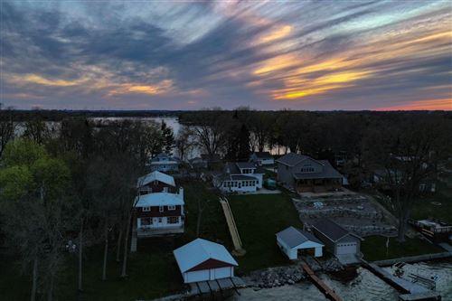 Photo of N10810 Maple Point, Fox Lake, WI 53933-9722 (MLS # 1882940)
