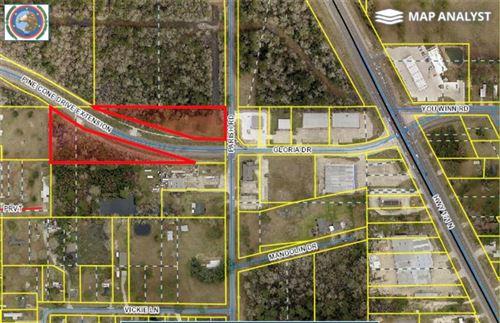 Photo of 879 Parish, Moss Bluff, LA 70611 (MLS # SWL21000776)