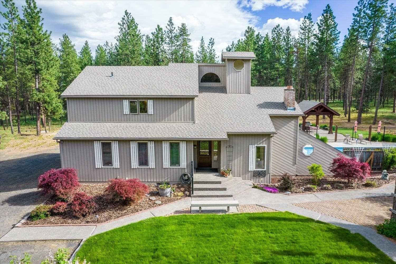 Photo of 9604 S Cedar Rim Ln, Spokane, WA 99224 (MLS # 202121455)