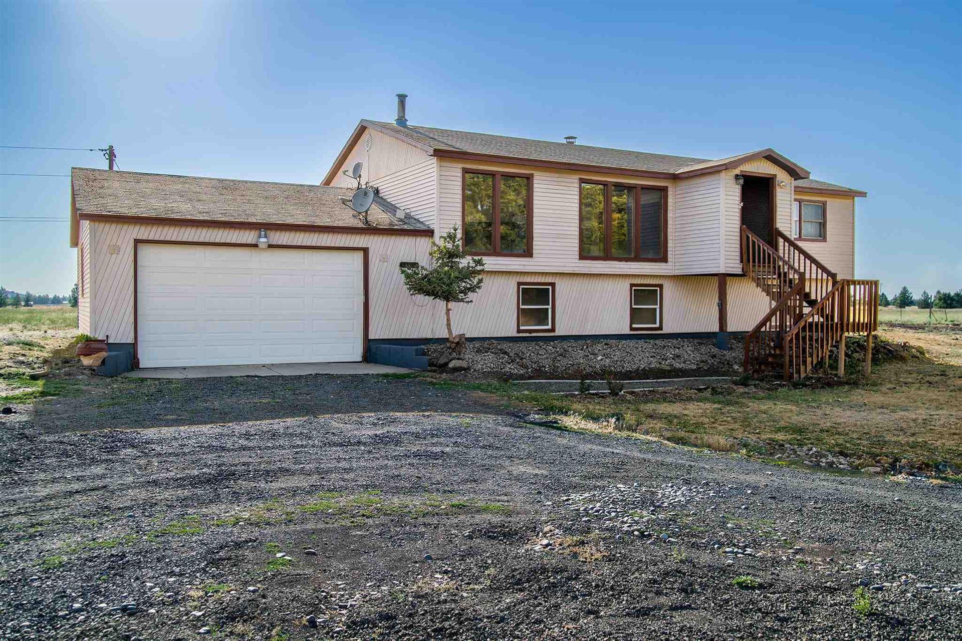 Photo of 13204 W White Rd, Spokane, WA 99224 (MLS # 202119486)