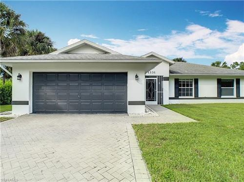 Photo of 1331 16th AVE SW, NAPLES, FL 34117 (MLS # 221076009)