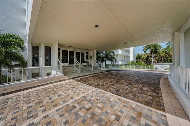 Photo of 6361 Pelican Bay BLVD #202, NAPLES, FL 34108 (MLS # 221056078)