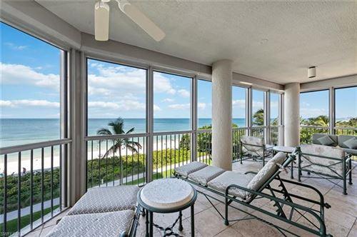 Photo of 4951 Gulf Shore BLVD N #203, NAPLES, FL 34103 (MLS # 221055087)